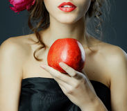 Red lips with red apple. Royalty Free Stock Photography