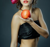 Red lips with red apple. Stock Photos