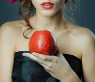Red lips with red apple. Royalty Free Stock Photos