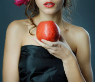 Red lips with red apple. Royalty Free Stock Images