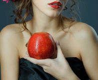 Red lips with red apple. Stock Photography
