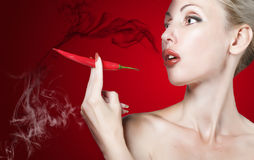 Red lips and red burning pepper Royalty Free Stock Images
