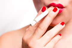 Red lips and red nails smoking cigarette V2 Stock Photo