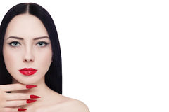 Red lips and stiletto nails. Portrait of young beautiful brunette with red lipstick and long stiletto nails over white background, copy space royalty free stock photography