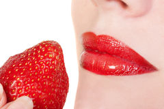 Red lips with strawberry Stock Image