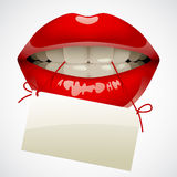 Red lips with a visiting card. Female sexy gloss red lips with a visiting card in the teeth. Opened sensual mouth of woman with business card. There is in Stock Photos