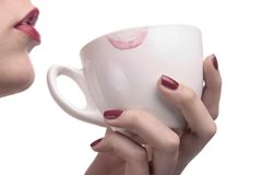 Red lips and white cup Royalty Free Stock Photography