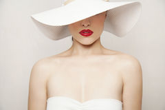 Red lips and white hat Royalty Free Stock Image