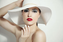 Red lips and white hat Stock Photos
