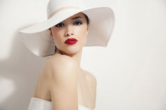 Red lips and white hat Stock Photography