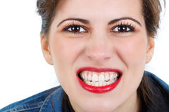 Red lips, white teeth Stock Photos
