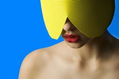 Red lips yellow mask Stock Image