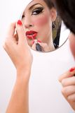 Red lipstic. Beautiful woman putting on red lipstic stock photography