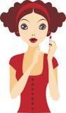 Red lipstick. Young beautiful girl doing makeup Stock Photo
