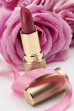 Red Lipstick. With bright pink rose background Royalty Free Stock Photography