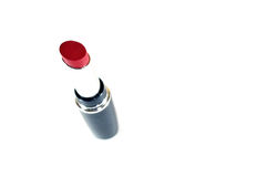 Red lipstick. Lipstick with reflection on white royalty free stock image