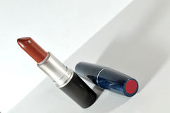Red lipstick. Lipstick with reflection on white Royalty Free Stock Photos