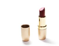 Red lipstick. Open tube of red lipstick on white background Royalty Free Stock Photos