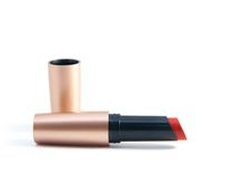 Red lipstick. Open tube of red lipstick on white background Stock Photo