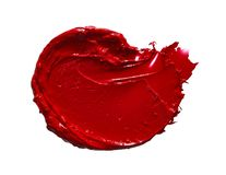 Red lipstick or acrylic paint isolated on white. Smear and texture of red lipstick or acrylic paint isolated on white background stock image