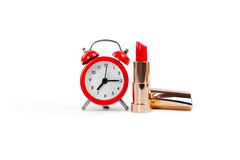 Red lipstick and alarm clock Stock Photo