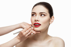 Red lipstick application Stock Photography