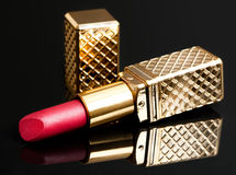 Red lipstick on black Stock Images