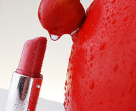 Red lipstick and cherry. With water drop stock photography