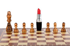 Red lipstick on a chessboard. Red lipstick in the role of the White Queen Royalty Free Stock Images