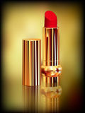 Red lipstick in gold tube. Created with gradient meshes. Stock Image