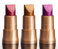 Red lipstick on grey Royalty Free Stock Photography
