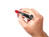 Red lipstick in hand Stock Photography