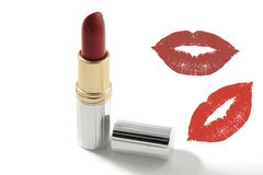 Red lipstick, with and a kiss silhouette Royalty Free Stock Images