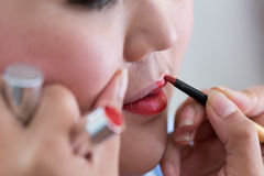 Red lipstick of makeup with cosmetic Stock Images