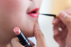 Red lipstick of makeup with cosmetic Royalty Free Stock Photography