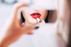 Red lipstick makeup sensual provocative woman. Red lipstick makeup seductive sensual provocative sexy woman lips concept Stock Images