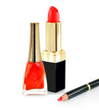 Red lipstick, nail polish and pencil. Red lipstick, nailpolish and pencil on white background Royalty Free Stock Images