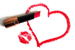Red lipstick, painted heart and imprint of lips on a white background Royalty Free Stock Photo