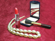 Red lipstick powder and beads Royalty Free Stock Image