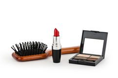 Red lipstick, powder and comb Stock Photos
