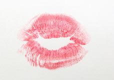 Red lipstick print on white background. Closeup Royalty Free Stock Photography