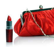 Red lipstick and purse Stock Photos