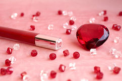 A red lipstick and a red diamond Stock Image