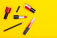 Red lipstick and red lip gloss. on yellow background. Copy space. Red lipstick and red lip gloss. on yellow background royalty free stock photos