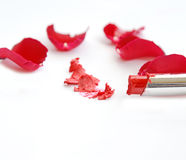 Red lipstick with red roses on white Royalty Free Stock Image