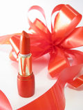 Red lipstick and ribbon Stock Images