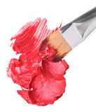 Red lipstick sample with makeup brushon whit Royalty Free Stock Image