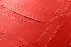 Red lipstick smears as background, closeup. stock photo