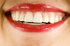 Red lipstick smile. Female smile with bright red lipstick and straight teeth Stock Photo