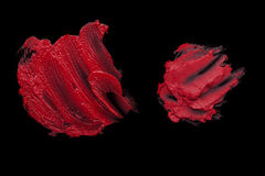 Red lipstick smudge. D on a black isolated background Stock Image
